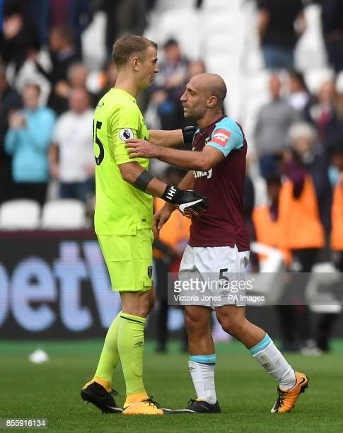 West Ham United goalkeeper Joe Hart and Pablo Zabaleta celebrate after the Premier League match at London Stadium