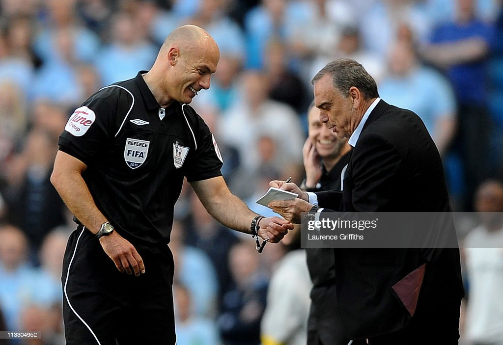 West Ham United Manager <a gi-track='captionPersonalityLinkClicked' href=/galleries/search?phrase=Avram+Grant&family=editorial&specificpeople=4506029 ng-click='$event.stopPropagation()'>Avram Grant</a> pretends to sign an autograph for Referee <a gi-track='captionPersonalityLinkClicked' href=/galleries/search?phrase=Howard+Webb&family=editorial&specificpeople=647148 ng-click='$event.stopPropagation()'>Howard Webb</a> after he dropped his notebook during the Barclays Premier League match between Manchester City and West Ham United at the City of Manchester Stadium on May 1, 2011 in Manchester, England.