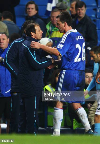 West Ham United Manager Gianfranco Zola shakes hands with John Terry of Chelsea after the Barclays Premier League match between Chelsea and West Ham...