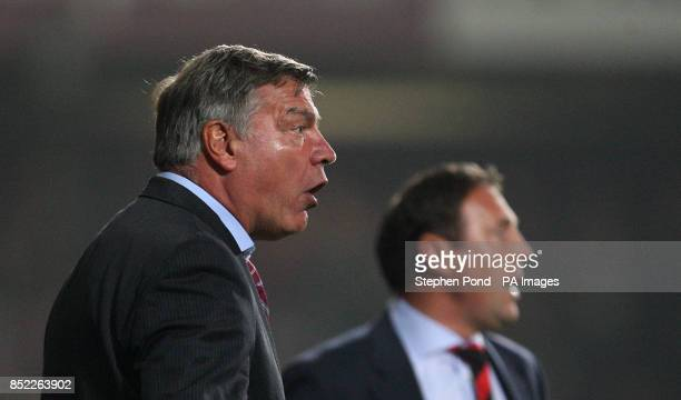 West Ham United Manager Sam Allardyce and Cardiff City Manager Malky Mackay on the touchline during the Capital One Cup Third round match at Upton...