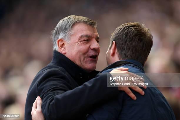 West Ham United Manager Sam Allardyce embraces Tottenham Hotspur Manager Tim Sherwood before the Barclays Premier League match at Upton Park London