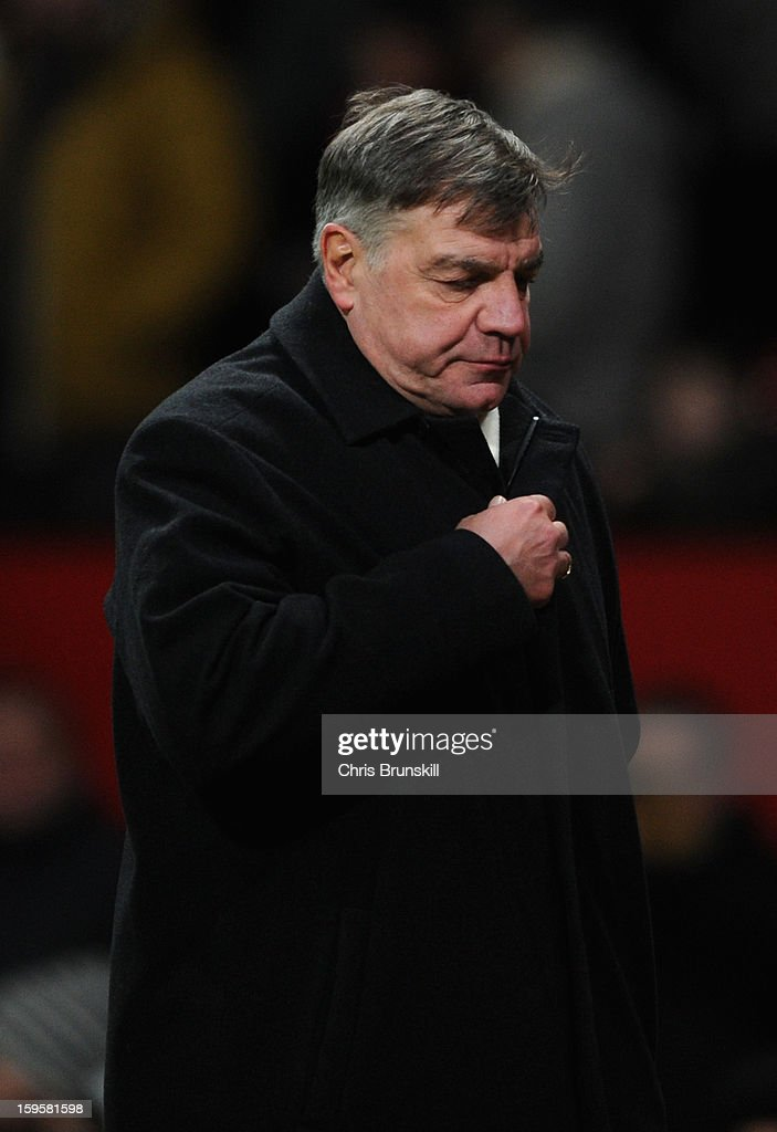 West Ham United Manager <a gi-track='captionPersonalityLinkClicked' href=/galleries/search?phrase=Sam+Allardyce&family=editorial&specificpeople=214691 ng-click='$event.stopPropagation()'>Sam Allardyce</a> heads for the dressing room at the end of the FA Cup with Budweiser Third Round Replay match between Manchester United and West Ham United at Old Trafford on January 16, 2013 in Manchester, England.