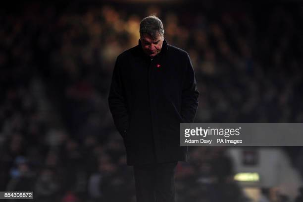 West Ham United manager Sam Allardyce looks dejected on the touchline