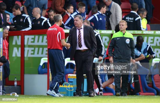 West Ham United manager Sam Allardyce shakes the hand of Crystal Palace caretaker manager Keith Millen after the Barclays Premier League match at...
