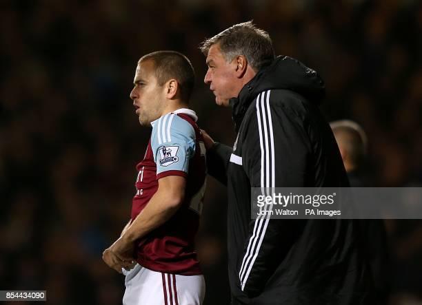 West Ham United manager Sam Allardyce speaks with Joe Cole on the touchline