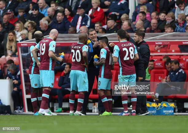 West Ham United manager Slaven Bilic gives instructions to his players during the Premier League match between Stoke City and West Ham United at...
