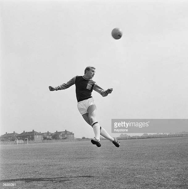 West Ham United player Bobby Moore heads the ball during a training session at the new ground at Chadwell Heath