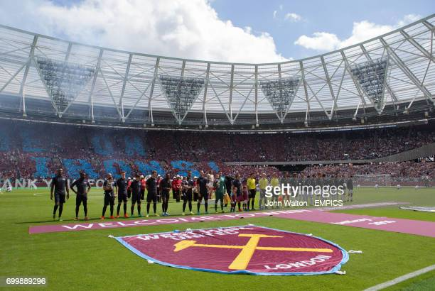 West Ham United players and Juventus players line up prior to kick off
