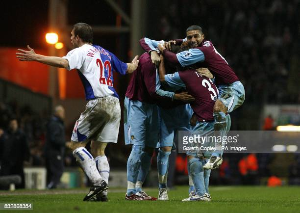 West Ham United players celebrate their sides second goal of the game as Blackburn Rovers' Stephen Warnock complains to the linesman