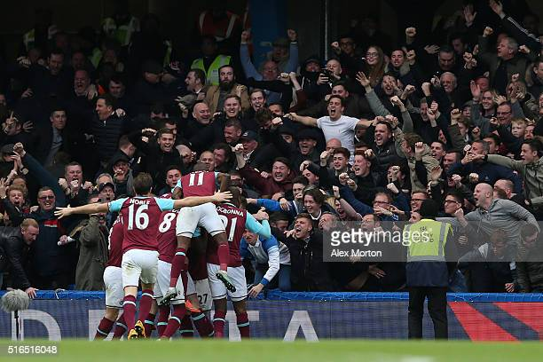 West Ham United players celebrate their team's second goal by Andy Carroll in front of their supporters during the Barclays Premier League match...