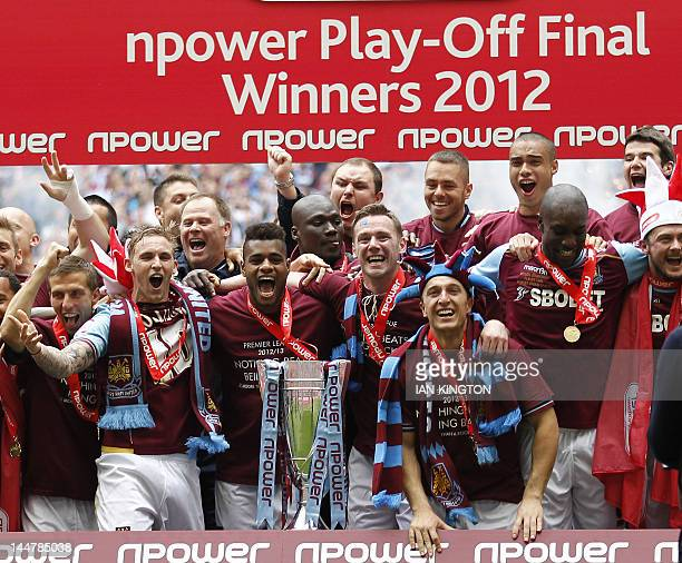 West Ham United players celebrate with the trophy after their victory in the 2012 Championship playoff final football match between West Ham United...
