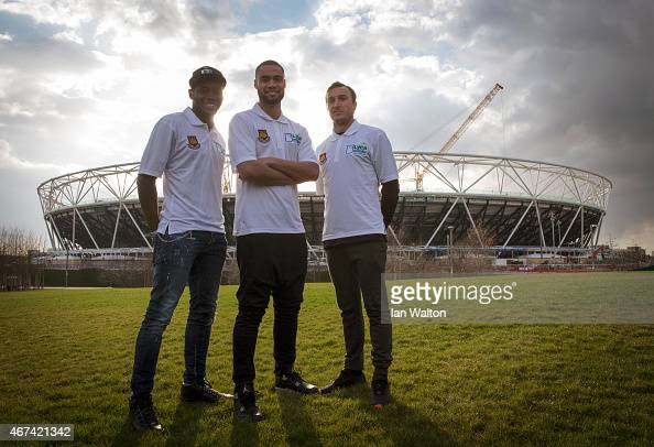 West Ham United players Diafra Sakho Winston Reid and Mark Noble poses for photographers outside the olympic stadium during a Lycamobile West Ham...