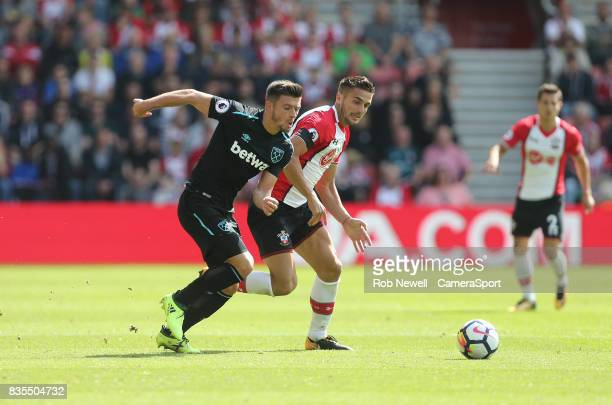 West Ham United's Aaron Cresswell and Southampton's Dusan Tadic during the Premier League match between Southampton and West Ham United at St Mary's...