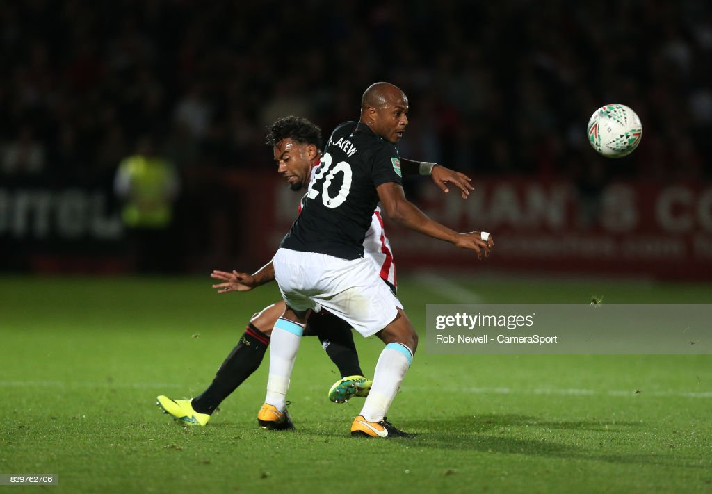 West Ham United's Andre Ayew and Cheltenham Town's Jordan Cranston during the Carabao Cup Second Round match between Cheltenham Town and West Ham United at Whaddon Road on August 23, 2017 in Cheltenham, England.