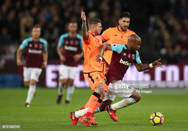 West Ham United's Andre Ayew and Liverpool's Alberto Moreno battle for the ball during the Premier League match at the London Stadium