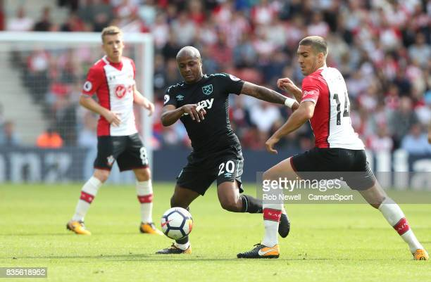 West Ham United's Andre Ayew and Southampton's Oriol Romeu during the Premier League match between Southampton and West Ham United at St Mary's...