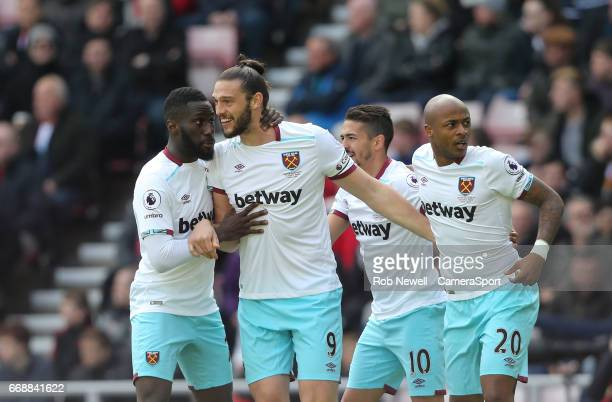 West Ham United's Andre Ayew is congratulated by Arthur Masuaku Andy Carroll and Manuel Lanzini after scoring his side's first goal during the...