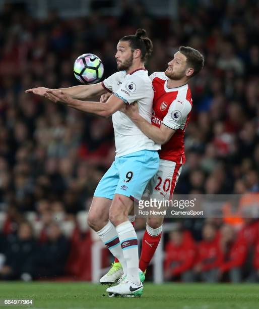 West Ham United's Andy Carroll and Arsenal's Shkodran Mustafi during the Premier League match between Arsenal and West Ham United at Emirates Stadium...