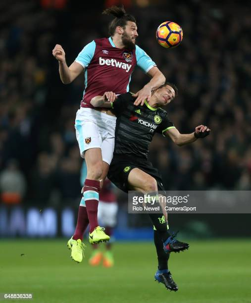 West Ham United's Andy Carroll and Chelsea's Cesar Azpilicueta during the Premier League match between West Ham United and Chelsea at London Stadium...