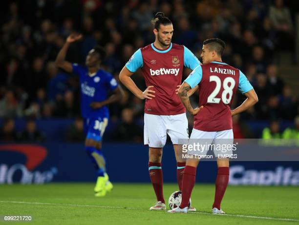 West Ham United's Andy Carroll and Manuel Lanzini stand dejected as Leicester City's Joe Dodoo celebrates scoring the first goal