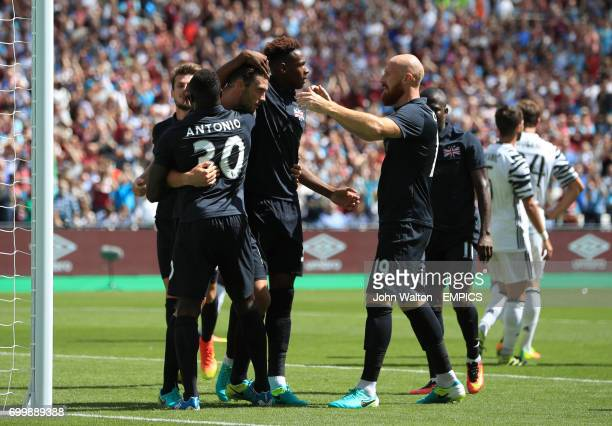 West Ham United's Andy Carroll celebrates scoring his side's second goal of the game with team mates Michail Antonio and James Collins