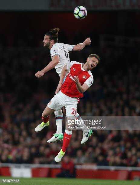 West Ham United's Andy Carroll challenges Arsenal's Shkodran Mustafi and is accused of using his elbow during the Premier League match between...