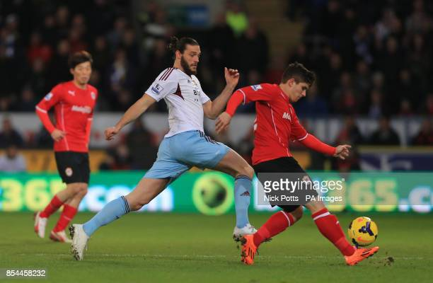 West Ham United's Andy Carroll challenges Cardiff City's Declan John during the Barclays Premier League match at Cardiff City Stadium Cardiff/...