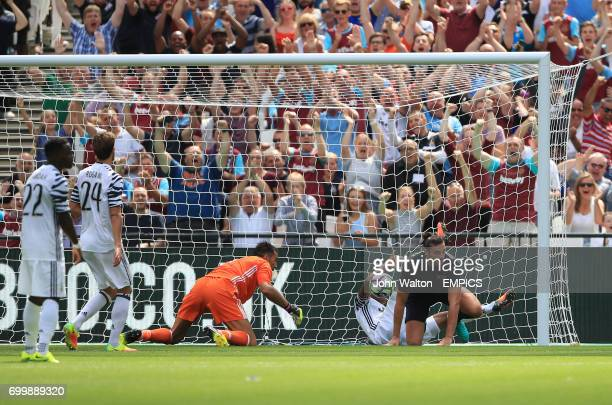 West Ham United's Andy Carroll scores his side's first goal of the game