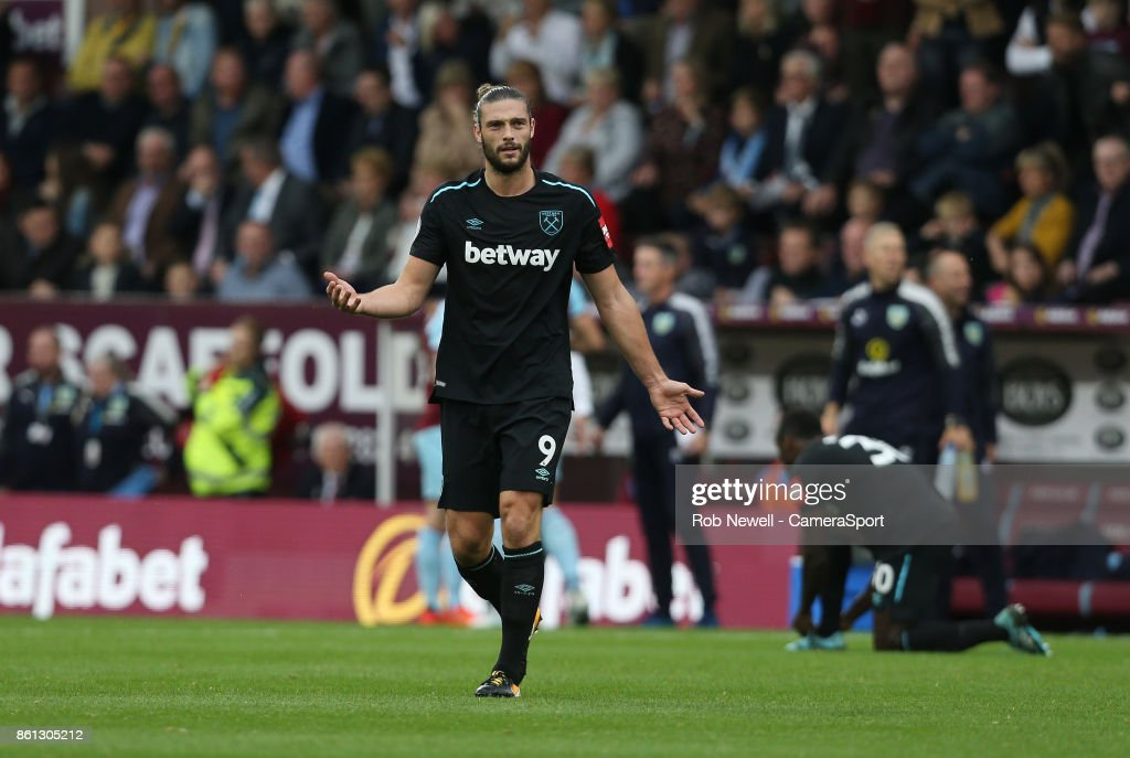 West Ham United's Andy Carroll walks off after being sent off during the Premier League match between Burnley and West Ham United at Turf Moor on October 14, 2017 in Burnley, England.