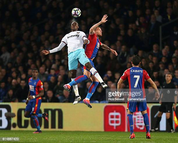 West Ham United's Angelo Ogbonna and Crystal Palace's Connor Wickham during the Premier League match between Crystal Palace and West Ham United at...