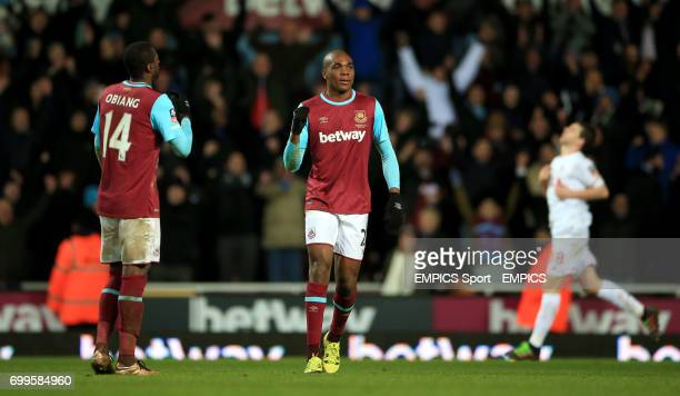 West Ham United's Angelo Ogbonna celebrates at the final whistle following the Emirates FA Cup fourth round replay match at Upton Park London