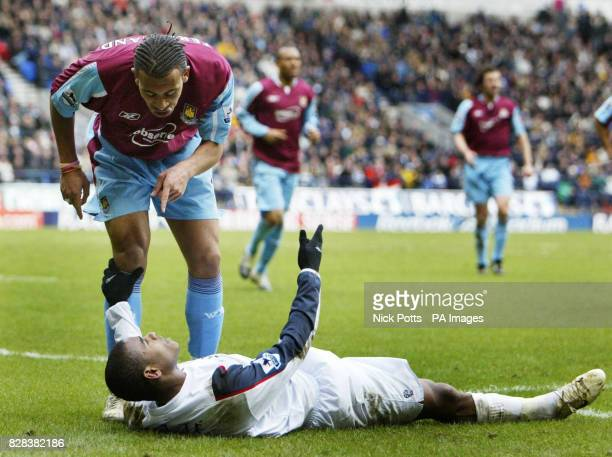 West Ham United's Anton Ferdinand points a finger at Bolton Wanderers' Ricardo Vaz Te after he tried to gain a penalty with a dive during Bolton's 41...