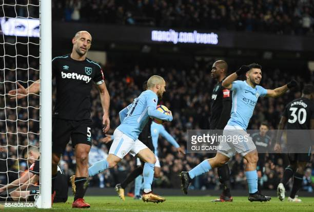 West Ham United's Argentinian defender Pablo Zabaleta reacts as Manchester City's Spanish midfielder David Silva and Manchester City's Argentinian...