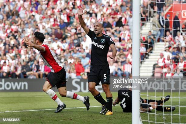West Ham United's Argentinian defender Pablo Zabaleta reacts as referee Lee Mason awards a final penalty to Southampton during the English Premier...