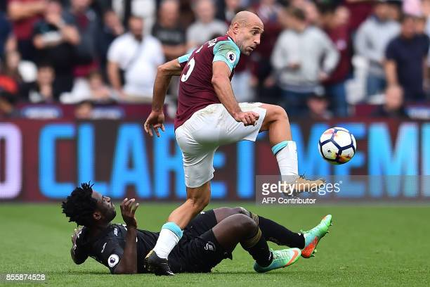West Ham United's Argentinian defender Pablo Zabaleta vies with Swansea City's Ivorian striker Wilfried Bony during the English Premier League...