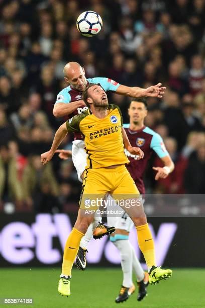 West Ham United's Argentinian defender Pablo Zabaleta vies with Brighton's English striker Glenn Murray during the English Premier League football...
