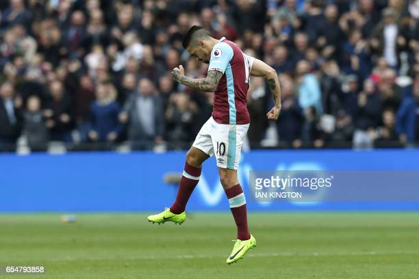 West Ham United's Argentinian midfielder Manuel Lanzini celebrates after scoring from a free kick during the English Premier League football match...