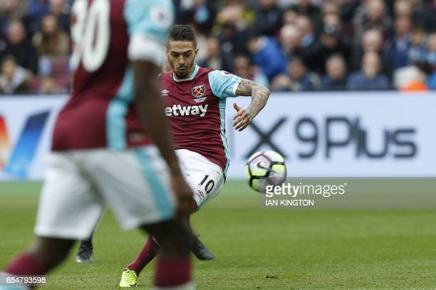 West Ham United's Argentinian midfielder Manuel Lanzini scores from a free kick during the English Premier League football match between West Ham...