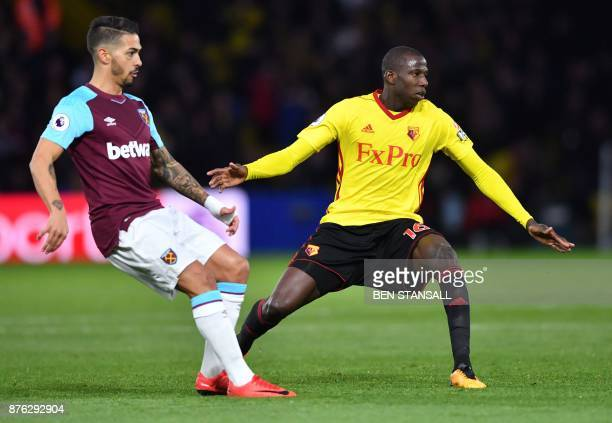 West Ham United's Argentinian midfielder Manuel Lanzini vies with Watford's French midfielder Abdoulaye Doucoure during the English Premier League...