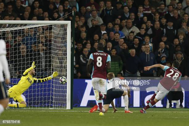West Ham United's Argentinian striker Jonathan Calleri has this shot saved by Tottenham Hotspur's French goalkeeper Hugo Lloris during the English...