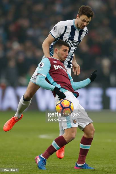 West Ham United's Argentinian striker Jonathan Calleri vies with West Bromwich Albion's Northern Irish defender Jonny Evans during the English...