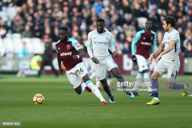 West Ham United's Arthur Masuaku and Chelsea's Tiemoue Bakayoko during the Premier League match between West Ham United and Chelsea at London Stadium...