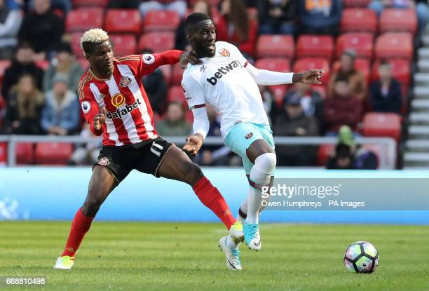 West Ham United's Arthur Masuaku and Sunderland's Didier Ibrahim Ndong battle for the ball during the Premier League match at the Stadium of Light...