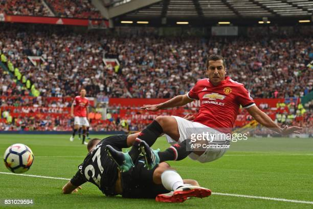 West Ham United's Austrian midfielder Marko Arnautovic vies with Manchester United's Armenian midfielder Henrikh Mkhitaryan during the English...