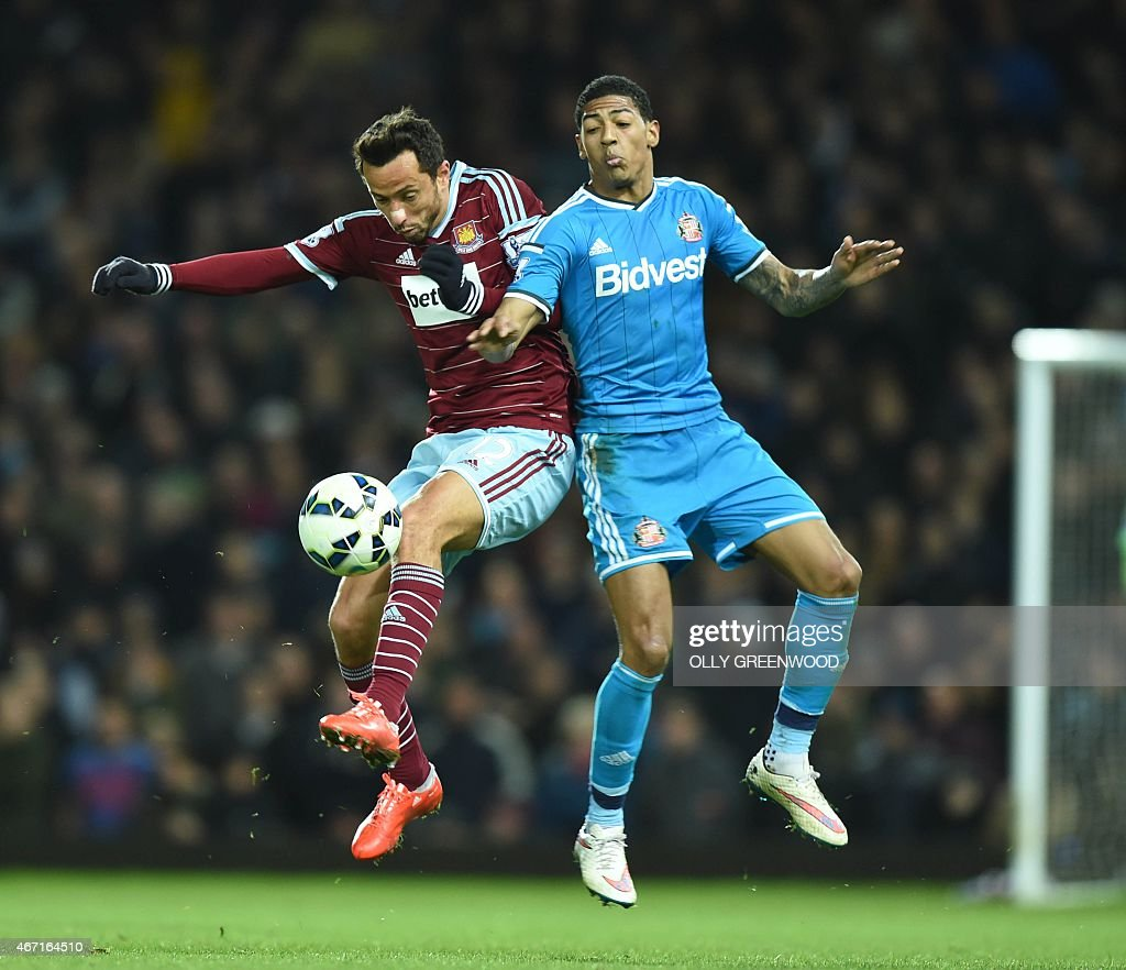 West Ham' United's Brazilian midfielder Nene (L) vies with Sunderland's Dutch defender <a gi-track='captionPersonalityLinkClicked' href=/galleries/search?phrase=Patrick+van+Aanholt&family=editorial&specificpeople=3542425 ng-click='$event.stopPropagation()'>Patrick van Aanholt</a> during the English Premier League football match between West Ham United and Sunderland at the Boleyn Ground in Upton Park, East London on March 21, 2015. West Ham won the game 1-0. AFP PHOTO / OLLY GREENWOOD