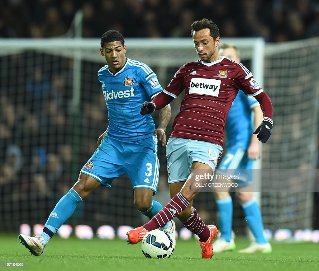 West Ham' United's Brazilian midfielder Nene (R) vies with Sunderland's Dutch defender <a gi-track='captionPersonalityLinkClicked' href=/galleries/search?phrase=Patrick+van+Aanholt&family=editorial&specificpeople=3542425 ng-click='$event.stopPropagation()'>Patrick van Aanholt</a> during the English Premier League football match between West Ham United and Sunderland at the Boleyn Ground in Upton Park, East London on March 21, 2015. West Ham won the game 1-0.