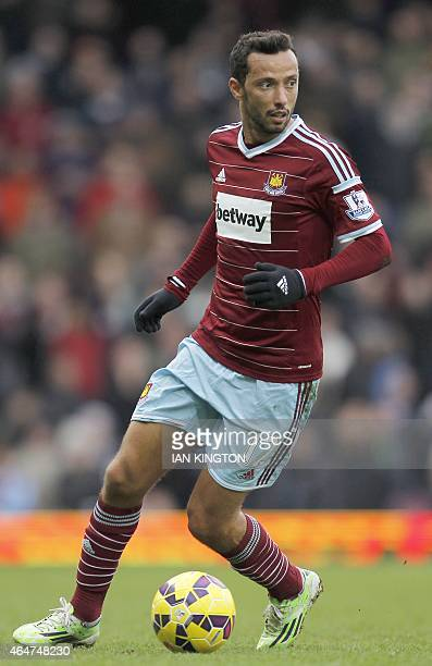 West Ham United's Brazilian striker Nene runs with the ball during the English Premier League football match between West Ham United and Crystal...