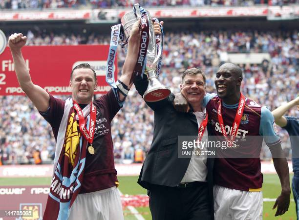 West Ham United's captain Kevin Nolan manager Sam Allardyce and goalscorer Carlton Cole celebrate with the trophy after their victory in the 2012...