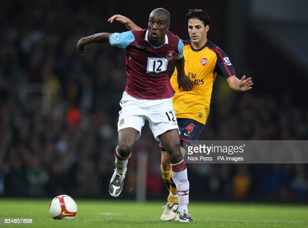 West Ham United's Carlton Cole and Arsenal's Francesc Fabregas battle for the ball