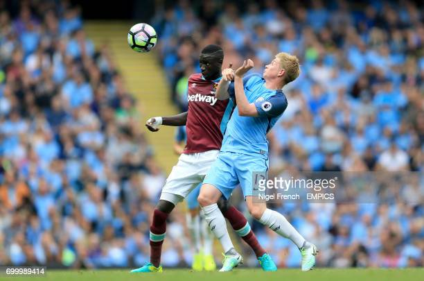 West Ham United's Cheikhou Kouyate and Manchester City's Kevin De Bruyne battle for the ball